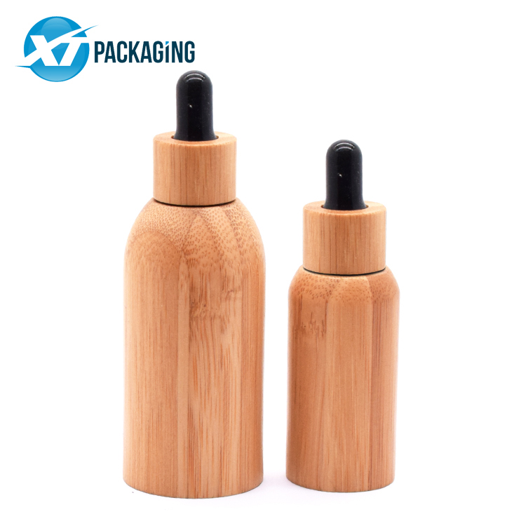 Custom 10ml 15ml 30ml 50ml 100ml 201ml bamboo Essential Glass Bottle for oil CBD oil child proof cap picture